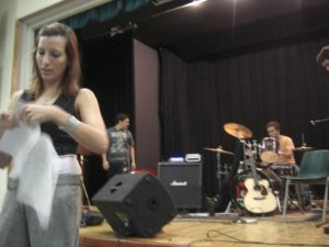 Preparations for Indie Rock band to perform. Drummer in the background.